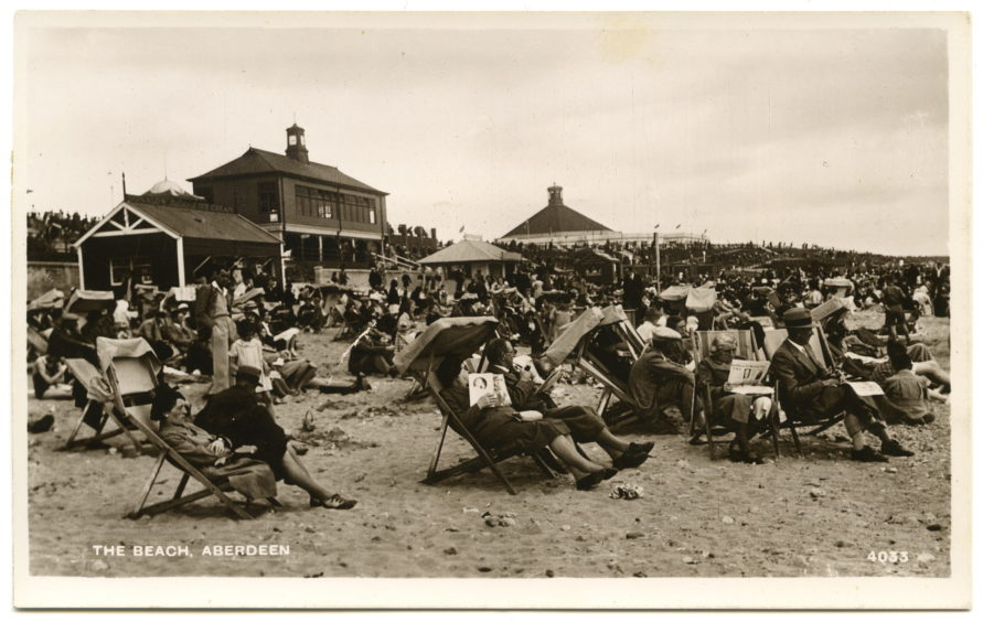 The mid-20th century heyday of Aberdeen beach as a tourist destination. Deck chairs were a popular feature of the beach up until the 1980s. They could be hired from three stations, each containing 1,800 chairs. Those with hoods were particularly in demand on sunny days.