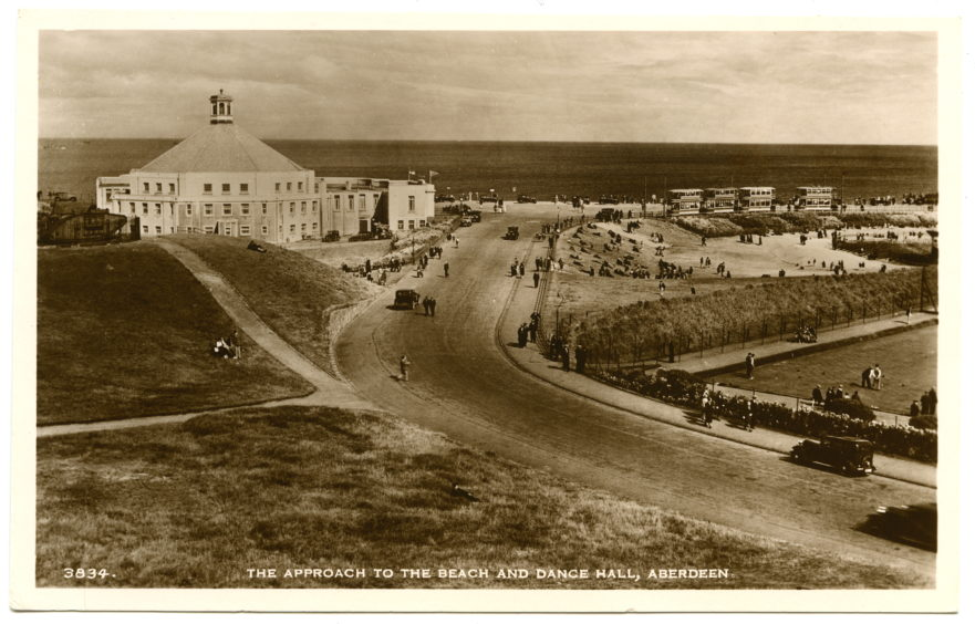 Postcard from the early 1930s showing key features of the beach as it takes shape as a destination; the Beach Ballroom, opened in 1929, the bandstand for musical performances and sports grounds. The trams that linked the beach to the city centre can also be seen at their terminus.
