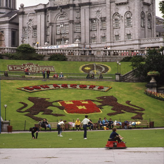Floral displays have also been central to the history of the park. This image from August 1979 shows the city's coat of arms as well as designs marking the centenaries of the Evening Express and the Scottish Salvation Army.