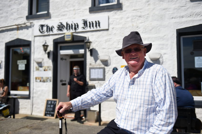 Taking a rest outside the Ship Inn in Stonehaven Harbour is Ian Emslie. Picture by Paul Glendell