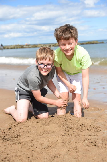Ellisi and Logan  Sinclair playing on Aberdeen Beach. Picture by Paul Glendell