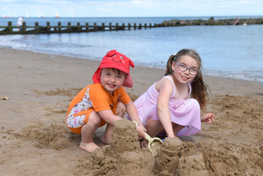 Sophie and Charlotte  building a sandcastle  on Aberdeen beach. Picture by Paul Glendell