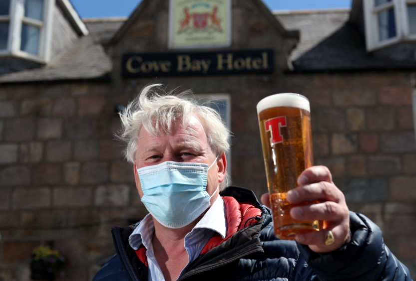Guy Craig, owner of the Cove Bay Hotel welcomes people to his new beer garden.