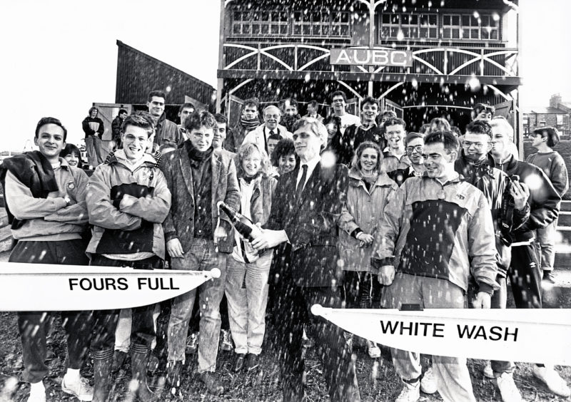 1989: Splashing in with £10,000 sponsorship Sysdrill managing director Dave Raby performs the champagne naming of the two new Aberdeen University Boat Club boats Fours Full and White Wash watched by Club captain Paul Nymah and members.