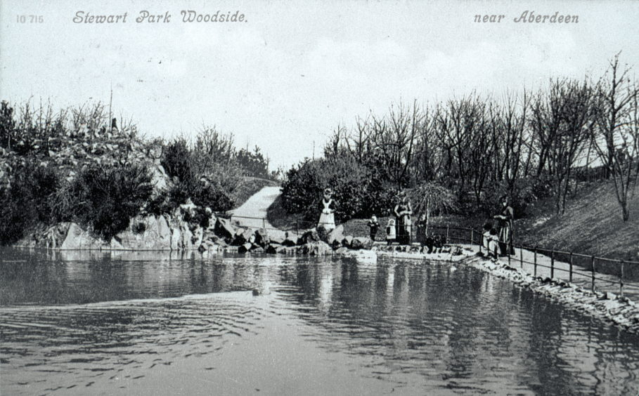 Postcard showing one of the two ponds within Stewart Park at the time of its opening. The ponds were adapted from holes created by the disused Hilton Quarries. The ponds were decorated with a range of attractive plants and rockery and were stocked with trout.