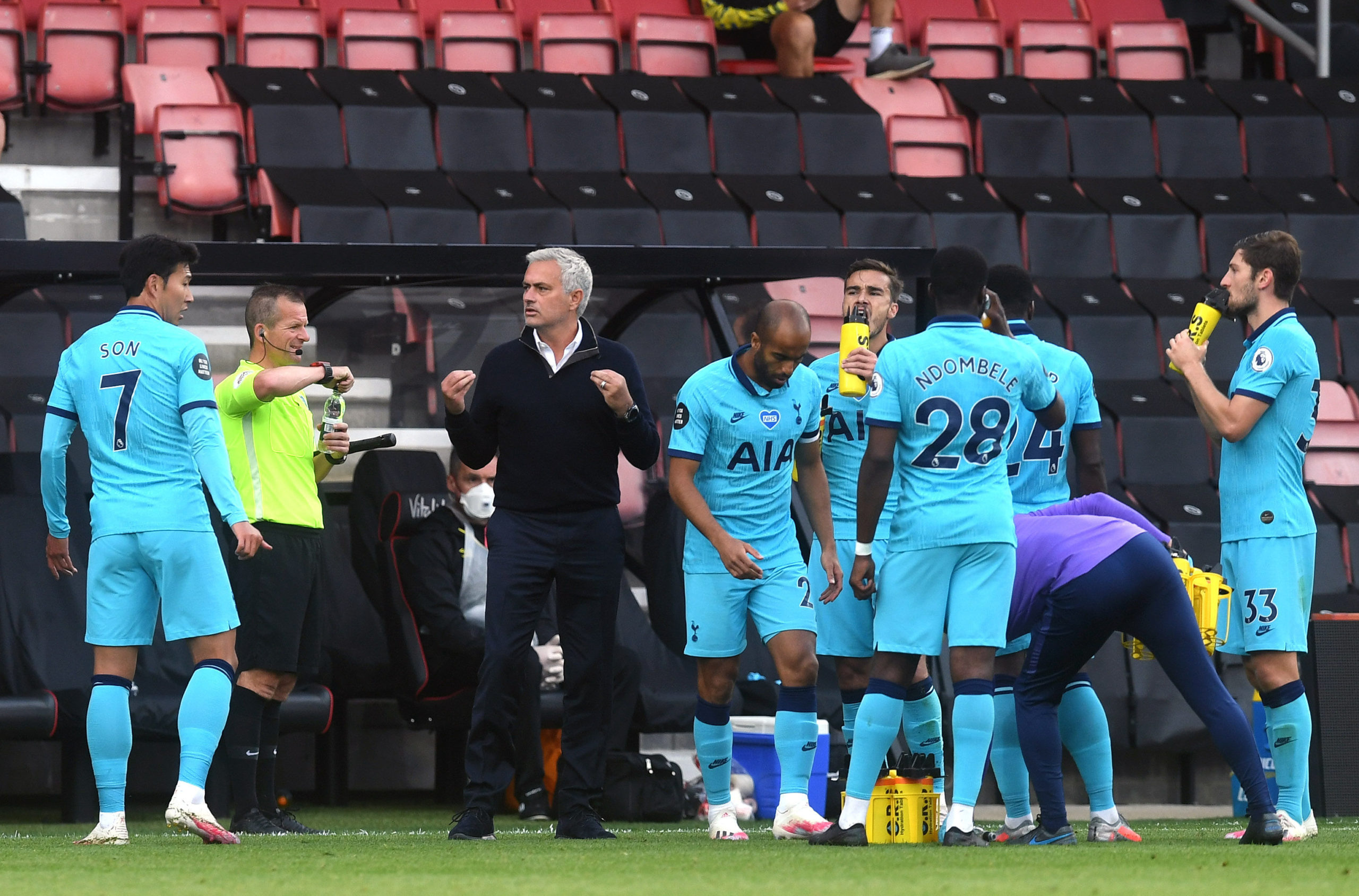 Tottenham Hotspur manager Jose Mourinho (left) gestures to players during a water break during the Premier League match at Vitality Stadium, Bournemouth.