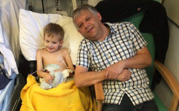 Sam and dad Graeme at Sick Kids Hospital in Edinburgh.