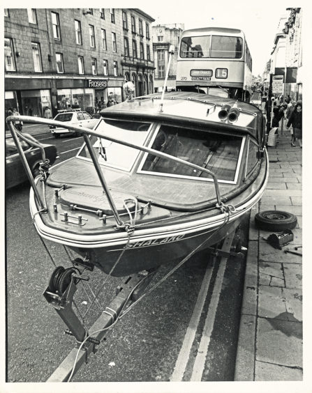 1983: Traffic wardens in Aberdeen's busy Union Street were all at sea when this 17ft boat ran aground. But as owner Ally Stephen revealed they were really quite friendly when they saw the unscheduled docking was unavoidable. For Shalako shed a wheel near the busy Market Street junction, and had to be left while Ally fetched tools to repair the stipped wheel nuts. Ally got the Shalako just over a year ago and keeps it at Stonehaven harbour. He was transporting the boat for a refit before the summer season. And with the benefit of some roadside repairs she was ready to finish her journey - after proving that not every master of a boat gets a ticket.