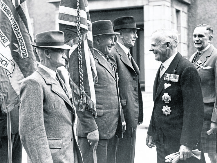 1948: Admiral Sir Lionel Wells K.C.B., D.S.O., inspecting the standard bearers at the British Legion Drumhead Commemoration Service at Hazlehead on Sunday.
