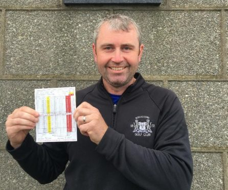 Barrie Edmond with his record scorecard.