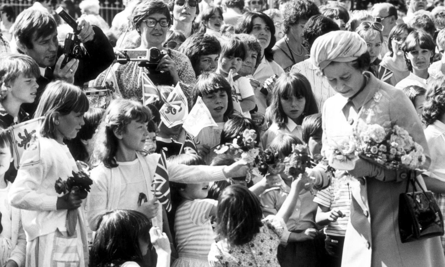 Youngsters with posies surround the Queen at the opening of Aberdeen's Queen Elizabeth Bridge in August, 1984. The Queen opened the £5.7 million bridge which is named after her. It replaced the Wellington Suspension Bridge over the Dee  between Torry and Ferryhill.