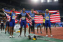 Isiah Young, Justin Gatlin, Noah Lyles and Michael Rodgers of the USA after the mens 4x100m relay final during the 2019 IAAF World Relay Championships