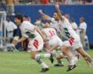 Bulgarian soccer players, from left: Daniel Borimirov, Ilian Kiriakov (16), Petra Houbtchev (5 partly hidden) and Hristo Stoitchkov (8) celebrate after Irodan Letchkov, unseen, scored the winning goal against Mexico in a penalty shootout during the second round World Cup soccer match at Giants Stadium, East Rutherford, New Jersey.