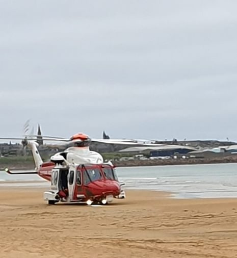 The coastguard rescue helicopter on the scene. Image courtesy of HM Coastguard Aberdeen City and Shire.