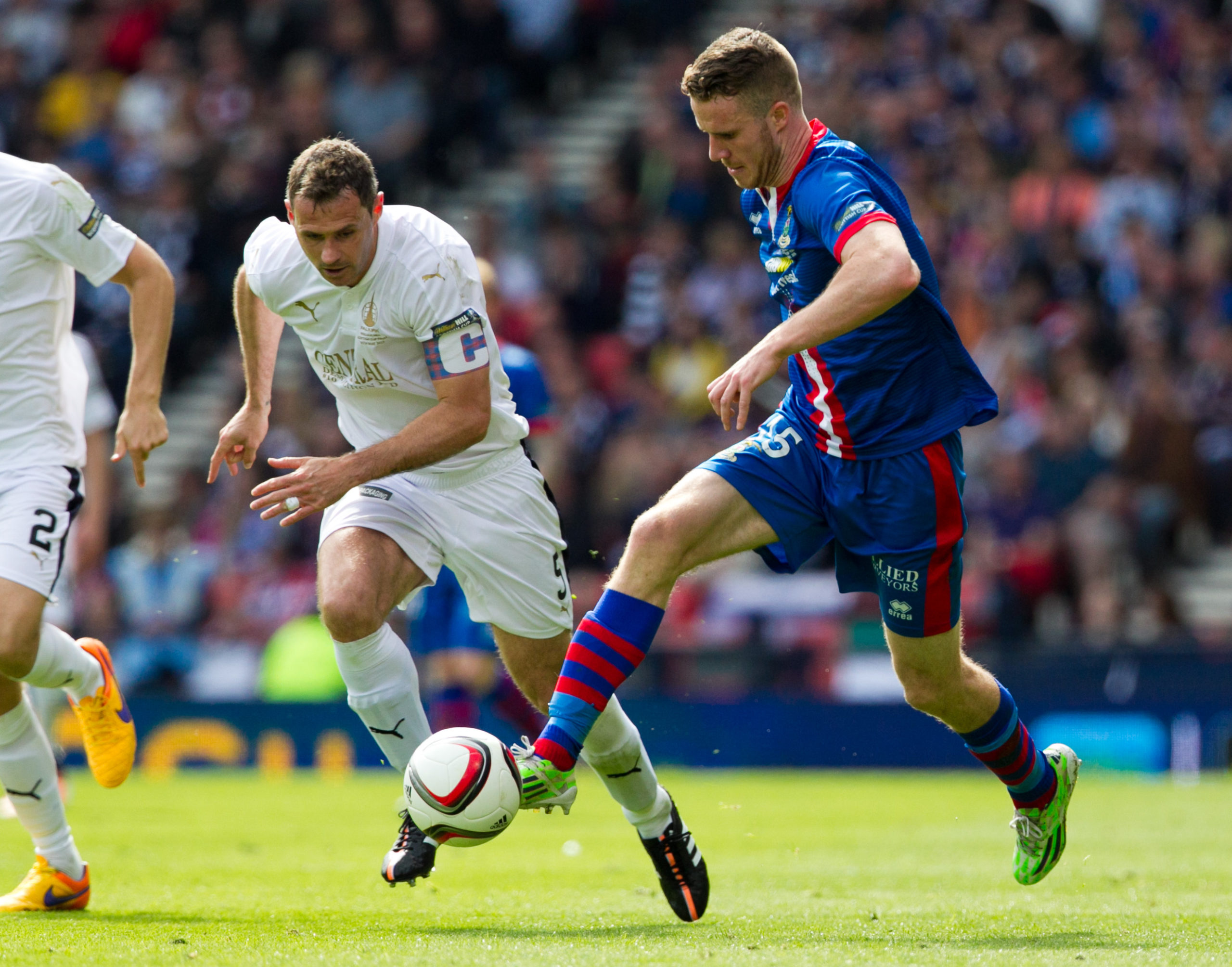 Marley Watkins in action for Caley Thistle.