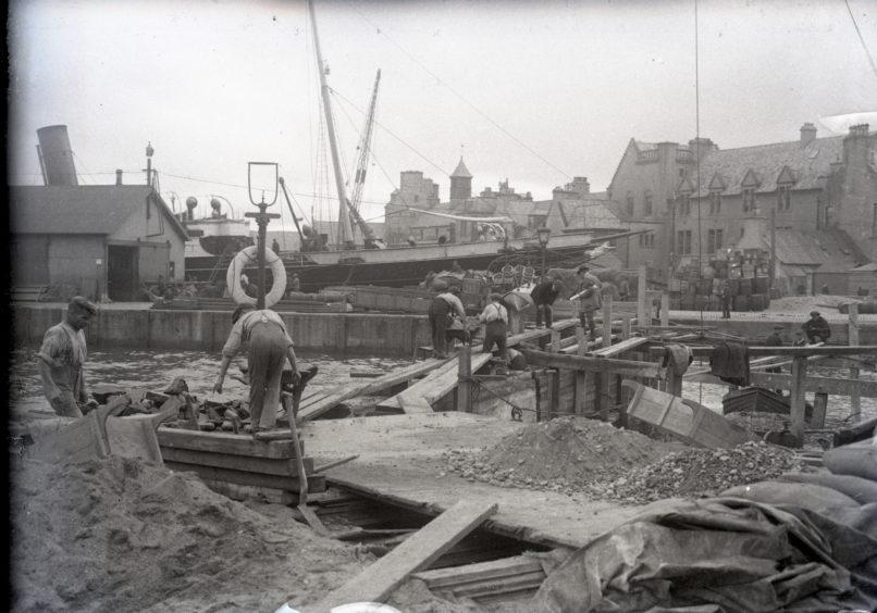 Men at work constructing quay