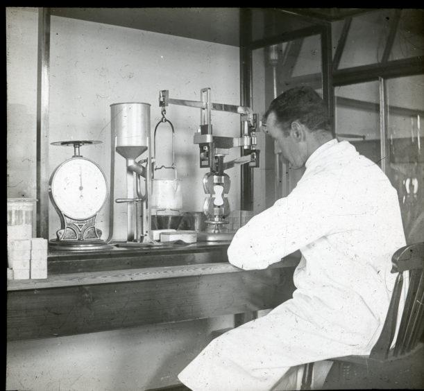 Scicentist working in laboratory at Matthews Quay