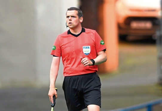Assistant referee and leader of the Scottish conservative party Douglas Ross MP during the Scottish Premiership match at Ibrox Stadium, Glasgow.