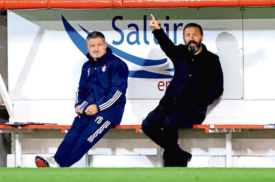 Aberdeen manager Derek McInnes (right) gestures from the bench during the UEFA Europa League qualifying first round match at Pittodrie Stadium.