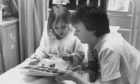 1993: Nursery nurse Helen Polsen gives patient Jacqueline Arbuthnott, Torphins, some help with her designs in fuzzy felt at Royal Aberdeen Children's Hospital.