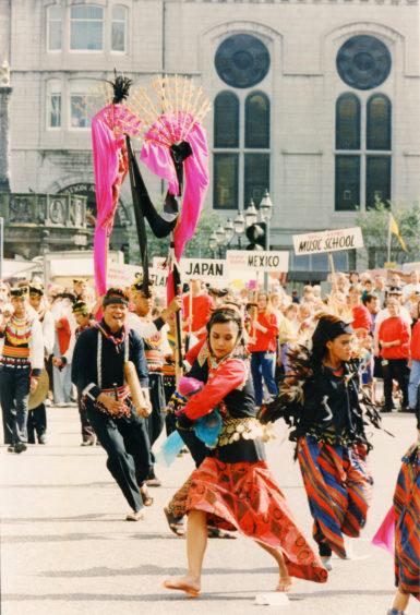1991: Odori Japanese Dancers cavort along Union Street as the Aberdeen International Youth Festival gets underway.
