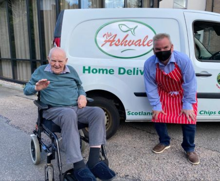 Billy Allan and Stuart Devine after The Ashvale donated portions of fish and chips to residents in the dementia unit at Deeside Care Home