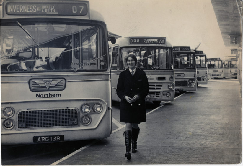 1974:  A smiling 'clippie' at Guild Street bus station is glad to be back at work in 1974 after a dispute was settled and picketing ended.