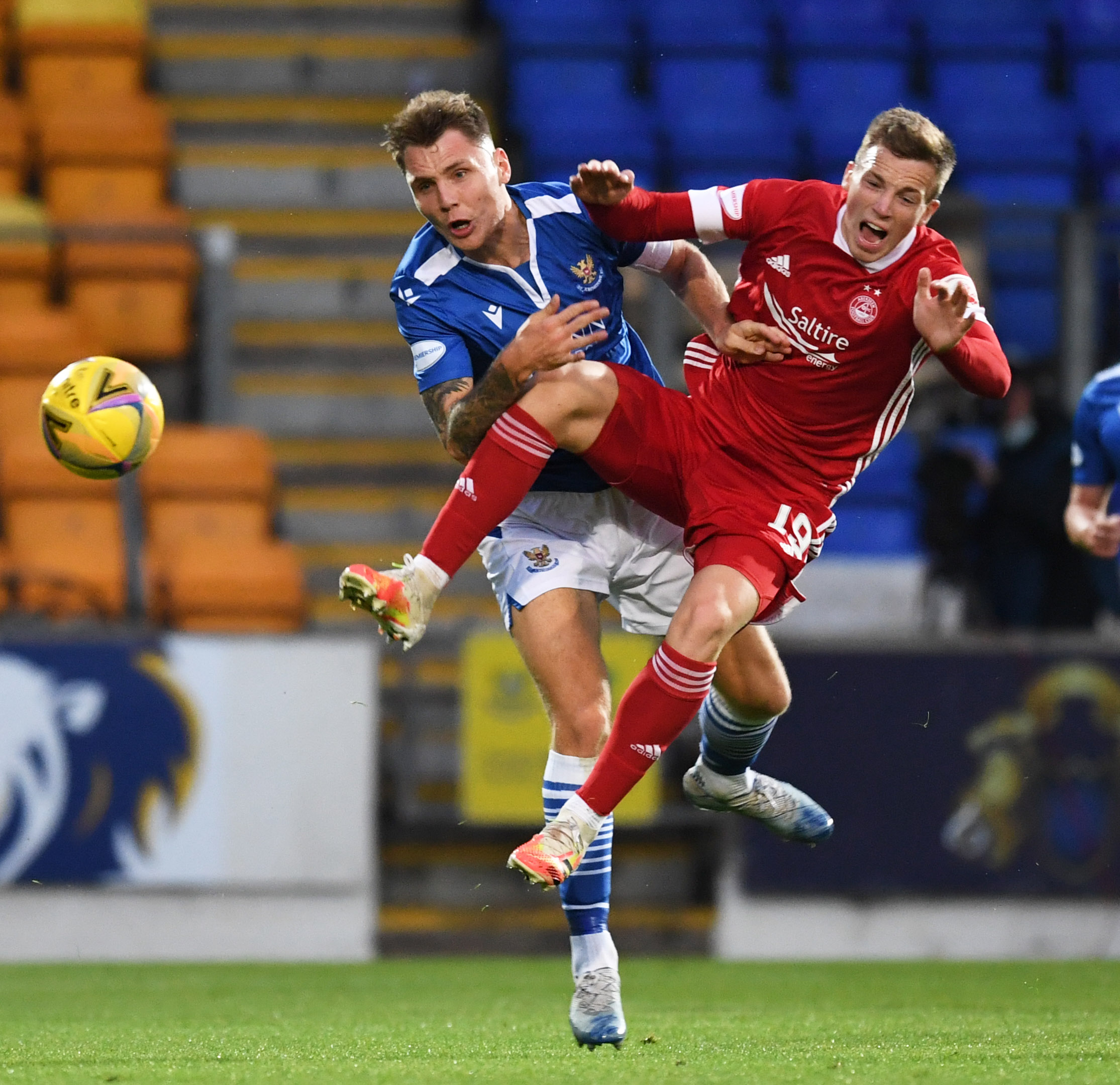 Lewis Ferguson (right) is challenged by Jason Kerr during the Scottish Premiership match between St Johnstone and Aberdeen at McDiarmid Park.