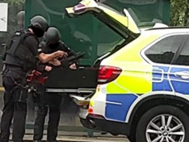 Armed police at the scene on Holburn Street this afternoon.