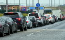 Cars queuing outside the coronavirus testing centre at Aberdeen Airport. Picture by Chris Sumner