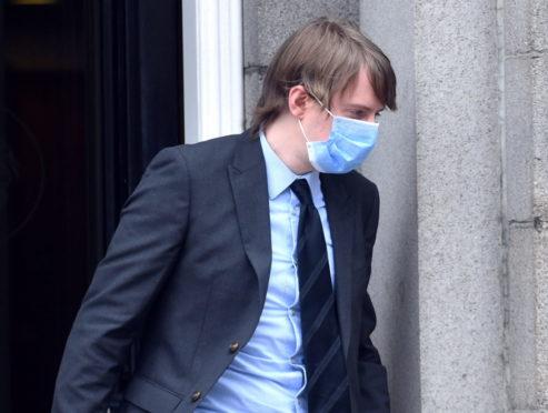 Jonathan Taylor leaving court.