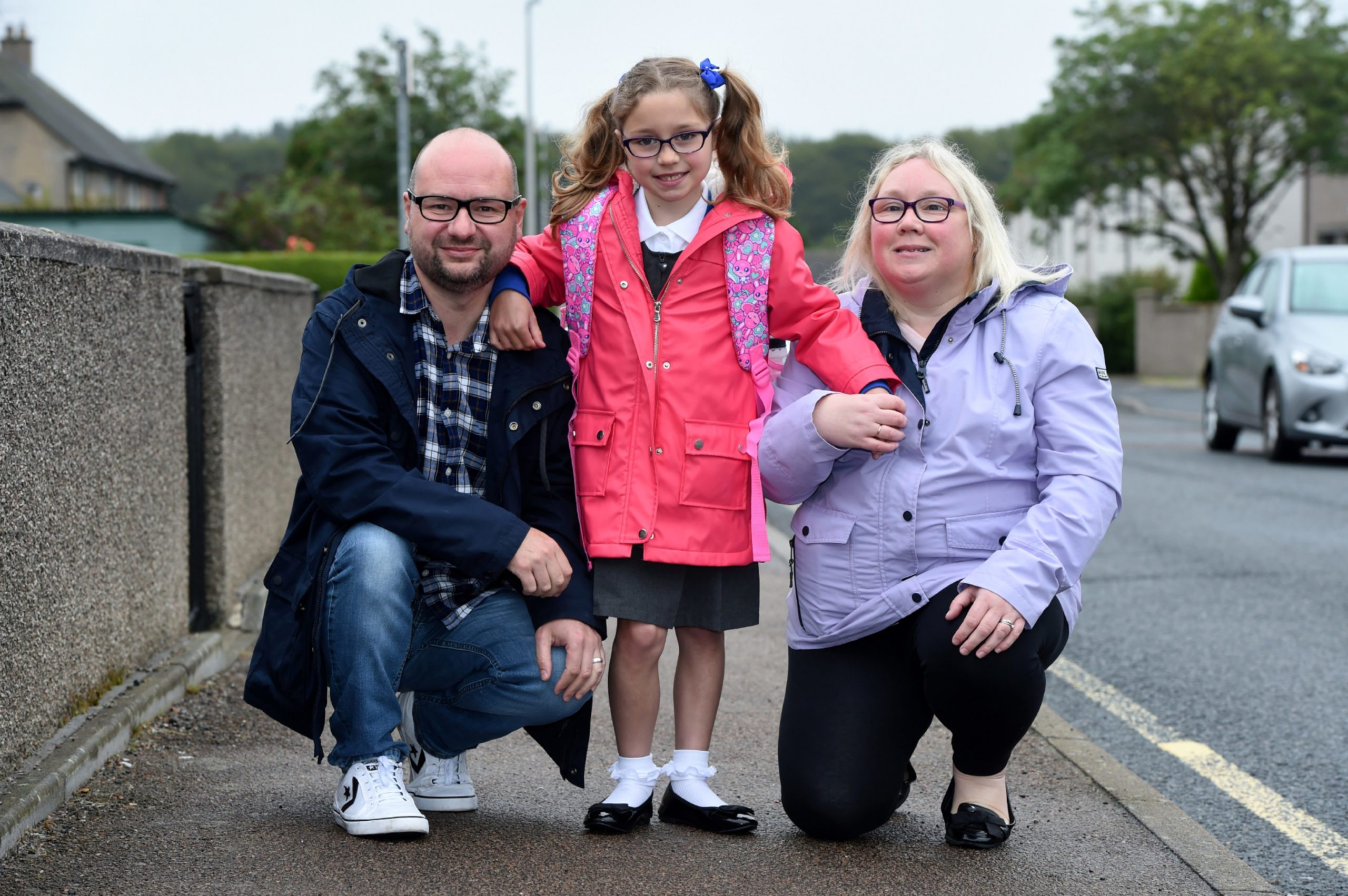 """Neale and Deanne Taylor with Katie, 8, who her mum described as """"our little miracle""""."""