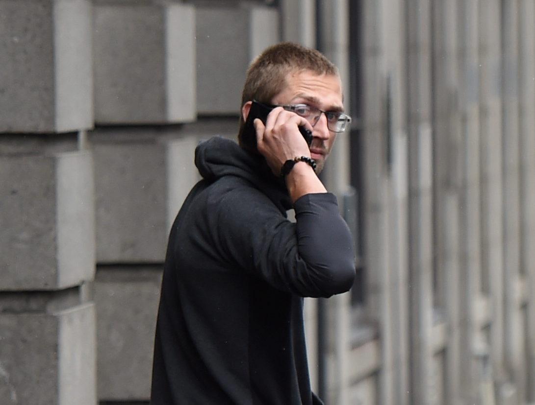 Nerijus Peciukevicius leaving court.