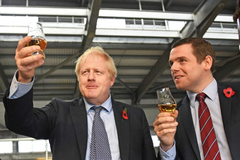 Douglas Ross, right, the front-runner to become Scottish Tory leader, with Boris Johnson.
