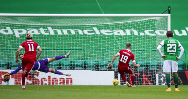 Lewis Ferguson scores a penalty against Hibs at Easter Road in August