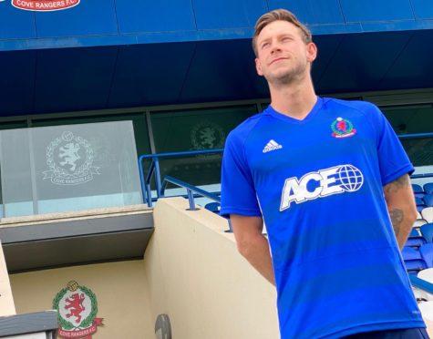 Mitch Megginson models Cove Rangers' new home kit.