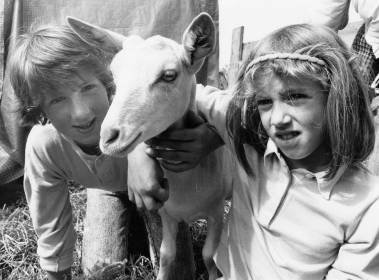 1988: All kids together ... Mary Ross and sister Rosana, Balmedie Farm, with one of their goat kids, Flax, at the New Deer Show on Saturday.