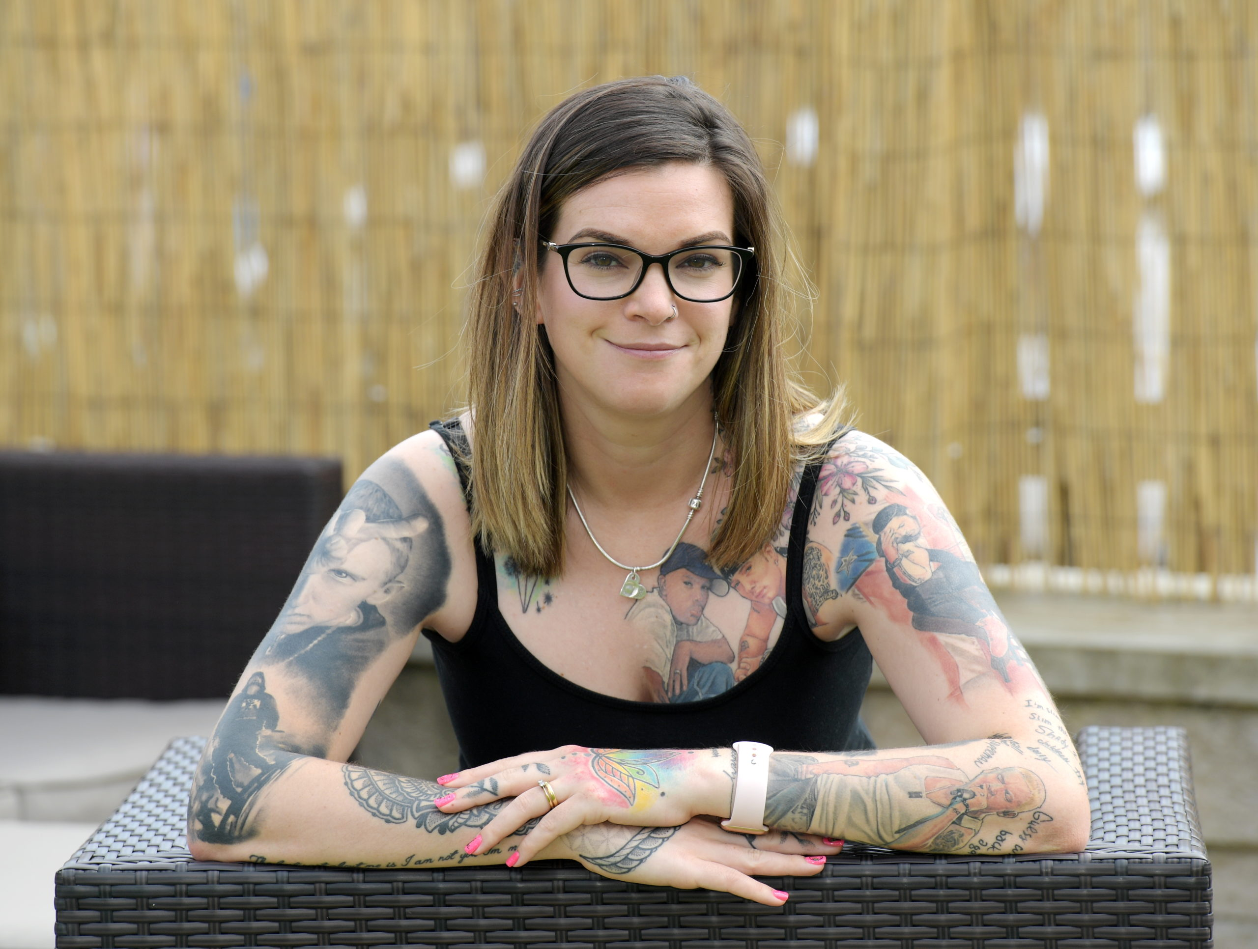 Nikki Paterson has broken the world record for the most tattoos of a musician on her body