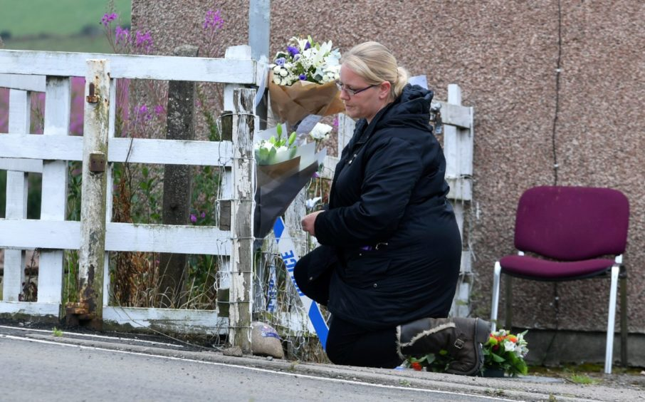 Floral tributes laid at Carmont signal box.