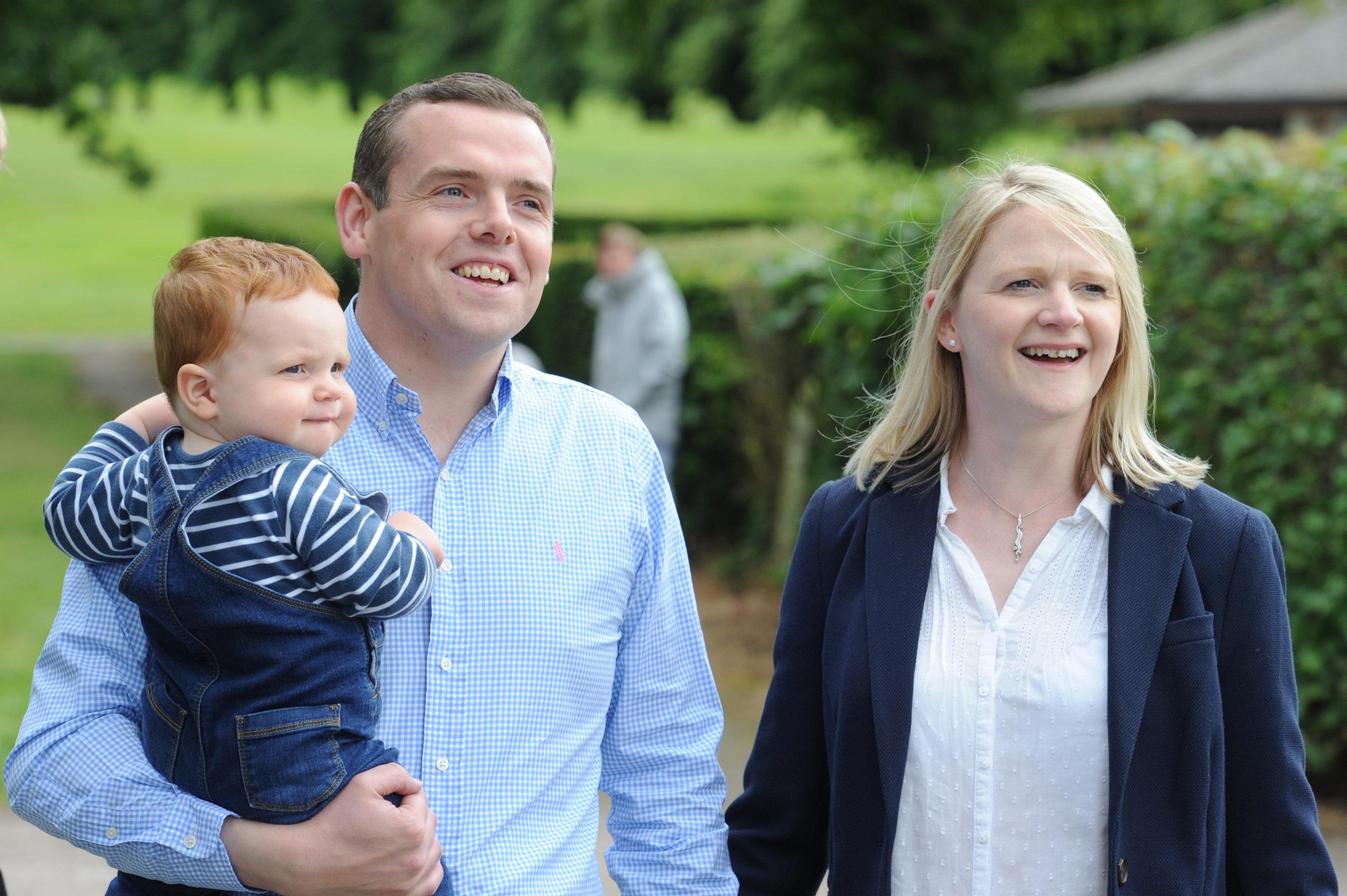 Douglas Ross with wife Krystle and son Alistair in Grant Park, Forres after being appointed leader of the Scottish Conservatives today.