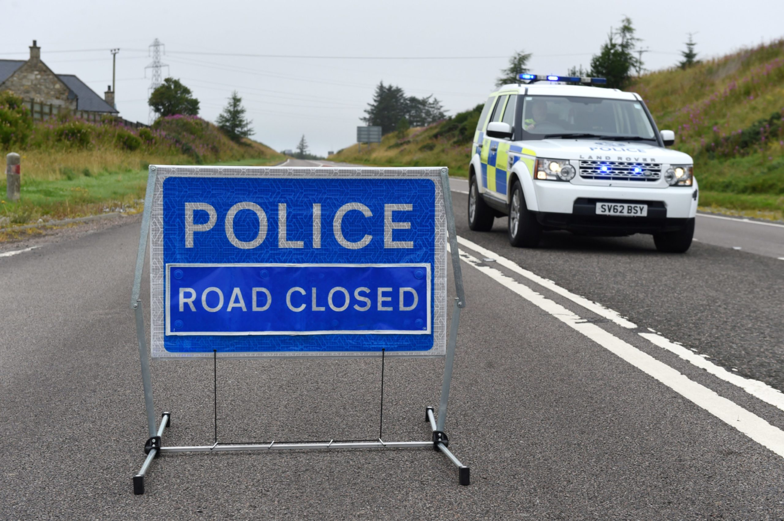 Police Scotland at the scene of the road accident on the A96 between Huntly and Keith – a pedestrian was pronounced dead at the scene