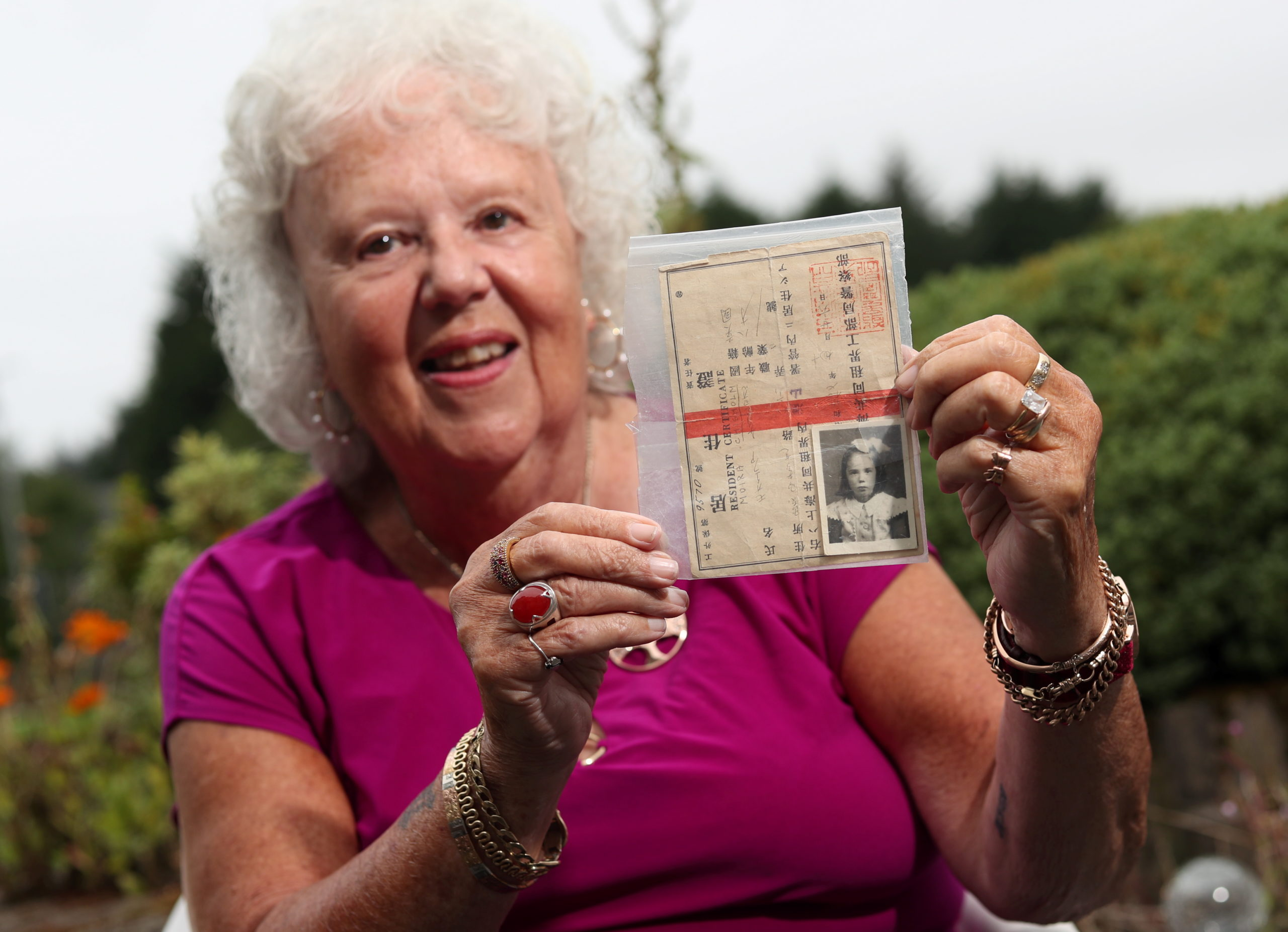 Moira Barbour holds up her prisoner of war ID card. Picture by Scott Baxter