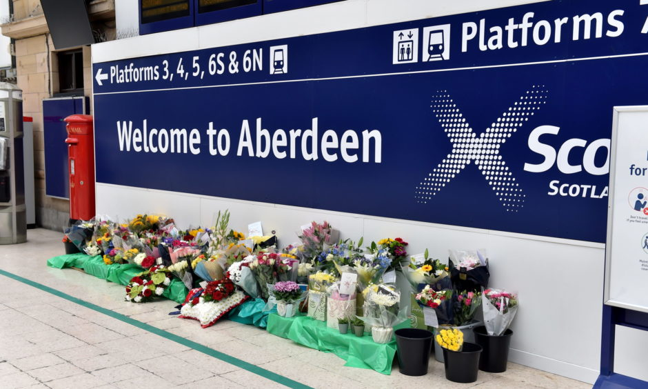 Flowers have been left at Aberdeen train station in memory of the victims. Picture by Scott Baxter