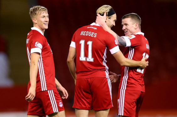Aberdeen blitzed the Faroe Islands' Runavik 6-0 in the first qualifying round