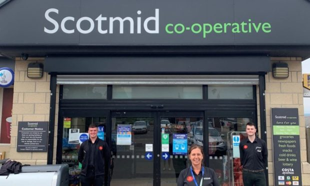 Scotmid staff members in the photo are Fraser Stuart, Elaine Arthur and Dan Barber.