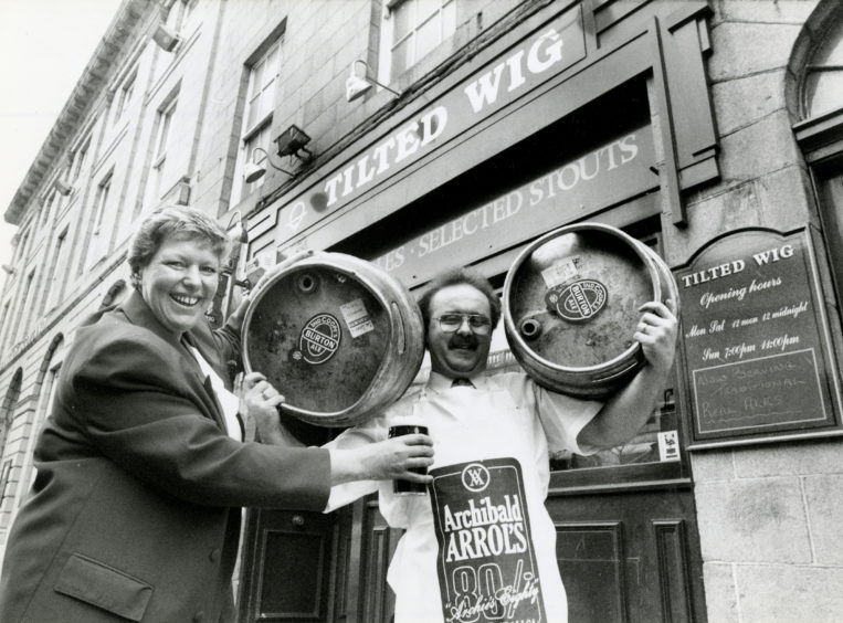 1992: Tilted Wig cellarman Paul Newall, who is hard at work getting the city centre pub ready for its beer festival next week, receives a welcome pint from manageress Maureen McMahon.