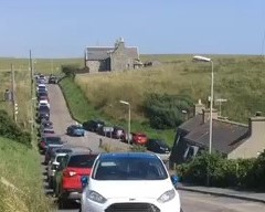 A large number of cars were parked along the road near Collieston