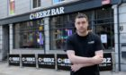 Not the same without the music... Cheerz Bar manager George Mackenzie won't be pulling pints for a while pending restrictions review