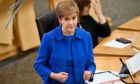 First Minister Nicola Sturgeon announces a range of new measures to combat the rise in coronavirus cases in Scotland, in the debating chamber of the Scottish Parliament in Edinburgh.