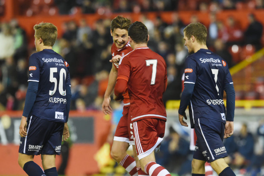 Ash Taylor and Kenny McLean celebrate the latter's winner